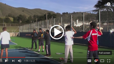 High school players learn serve with ServeMaster